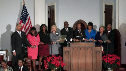 "U.S. Democratic presidential candidate Hillary Clinton (4th L) sings ""We Shall Overcome"" with other speakers at the National Bar Association's 60th Anniversary of the Montgomery Bus Boycott December 1, 2015 in Montgomery, AL. REUTERS/Marvin Gentry"