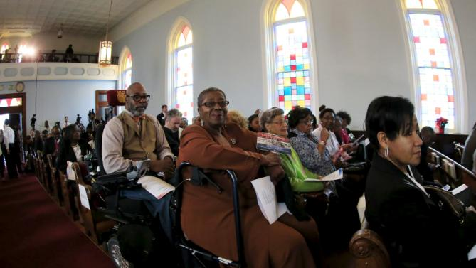 Members of the church wait to see U.S. Democratic presidential candidate Hillary Clinton speak at the National Bar Association's 60th Anniversary of the Montgomery Bus Boycott in Montgomery, December 1, 2015. REUTERS/Marvin Gentry