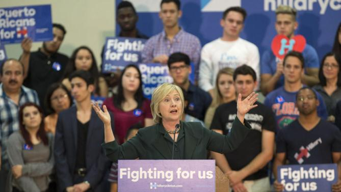 Democratic presidential candidate Hillary Clinton speaks at a Grassroots Organizing Event at the Meadow Woods Recreation Center in Orlando, Fla., Wednesday, Dec. 2, 2015. (AP Photo/Willie J. Allen Jr.)