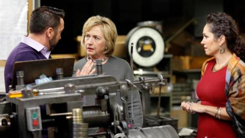 Democratic presidential candidate Hillary Clinton speaks tAaron and Adria Bagshaw during a tour and campaign stop at WH Bagshaw, a 5th generation family owned business Thursday, Dec. 3, 2015, in Nashua, N.H. (AP Photo/Jim Cole)