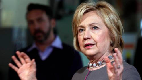 Democratic presidential candidate Hillary Clinton speaks to employees during a tour and campaign stop at WH Bagshaw, a 5th generation family owned business Thursday, Dec. 3, 2015, in Nashua, N.H. (AP Photo/Jim Cole)