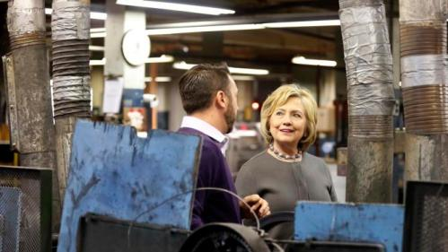 Democratic presidential candidate Hillary Clinton speaks to Arron Bagshaw during a tour and campaign stop at WH Bagshaw, a 5th generation family owned business Thursday, Dec. 3, 2015, in Nashua, N.H. (AP Photo/Jim Cole)