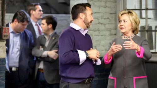 Democratic presidential candidate Hillary Clinton speaks to Aaron Bagshaw during a tour and campaign stop at WH Bagshaw, a 5th generation family owned business Thursday, Dec. 3, 2015, in Nashua, N.H. (AP Photo/Jim Cole)