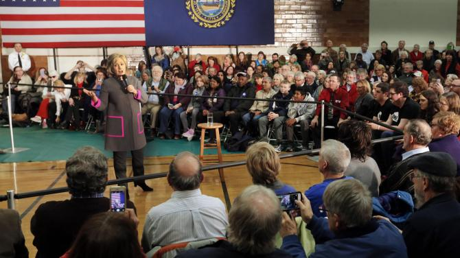 Democratic presidential candidate Hillary Clinton speaks to several hundred area residents during a town hall style meeting in the gymnasium at the McConnell Center Thursday, Dec. 3, 2015, in Dover, N.H. (AP Photo/Jim Cole)