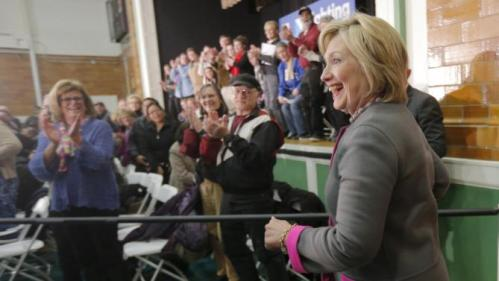 U.S. Democratic presidential candidate Hillary Clinton takes the stage for a campaign town hall meeting in Dover, New Hampshire, December 3, 2015. REUTERS/Brian Snyder