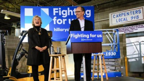 Democratic presidential candidate Hillary Clinton laughs as U.S. Secretary of Labor Tom Perez endorses her during a campaign stop in Sioux City, Iowa, Friday, Dec. 4, 2015. (AP Photo/Nati Harnik)