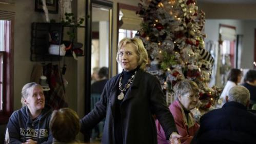 Democratic presidential candidate Hillary Clinton meets local residents at Apple Orchard Cafe Friday, Dec. 4, 2015, in Fort Dodge, Iowa. (AP Photo/Charlie Neibergall)