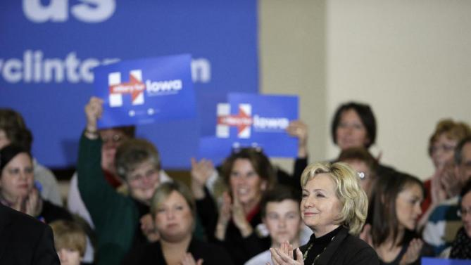 Democratic presidential candidate Hillary Clinton smiles as she arrives at a town hall meeting Friday, Dec. 4, 2015, in Fort Dodge, Iowa. (AP Photo/Charlie Neibergall)