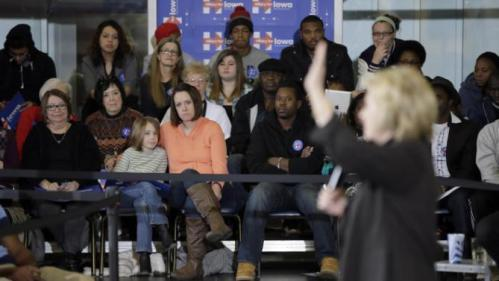 Supporters watch as Democratic presidential candidate Hillary Clinton speaks during a town hall meeting Friday, Dec. 4, 2015, in Fort Dodge, Iowa. (AP Photo/Charlie Neibergall)