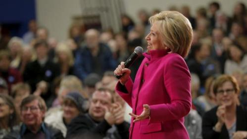 """U.S. Democratic presidential candidate Hillary Clinton reacts when an audience member calls her """"Madame President"""" at a campaign town hall meeting in Salem, New Hampshire December 8, 2015. REUTERS/Brian Snyder"""
