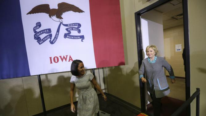 Democratic presidential candidate Hillary Clinton enters a town hall meeting, Wednesday, Dec. 9, 2015, in Waterloo, Iowa. (AP Photo/Charlie Neibergall)
