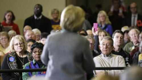Audience members listen as Democratic presidential candidate Hillary Clinton speaks during a town hall meeting, Wednesday, Dec. 9, 2015, in Waterloo, Iowa. (AP Photo/Charlie Neibergall)