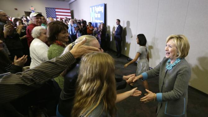 Democratic presidential candidate Hillary Clinton greets supporters before a town hall meeting, Wednesday, Dec. 9, 2015, in Waterloo, Iowa. (AP Photo/Charlie Neibergall)