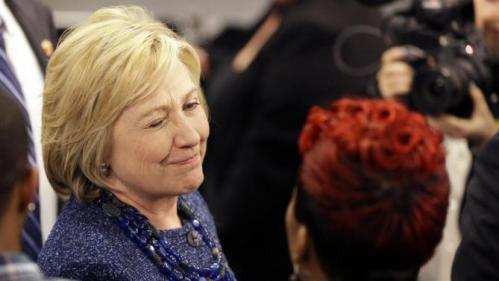 Democratic presidential candidate Hillary Clinton winks as she speaks to Lesley McSpadden, right, the mother of Michael Brown, while working the rope line during a campaign stop at a union hall on Friday, Dec. 11, 2015, in St. Louis. Brown was shot and killed by a Ferguson police officer in Aug. 2014 setting off the Black Lives Matter movement. (AP Photo/Jeff Roberson)
