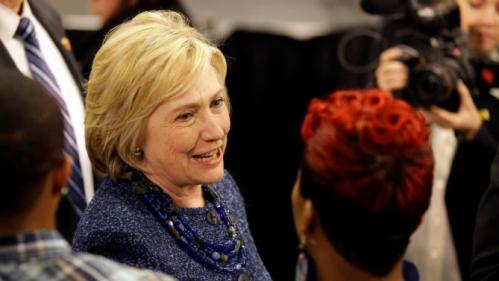 Democratic presidential candidate Hillary Clinton speaks to Lesley McSpadden, right, the mother of Michael Brown, while working the rope line during a campaign stop at a union hall on Friday, Dec. 11, 2015, in St. Louis. Brown was shot and killed by a Ferguson police officer in Aug. 2014 setting off the Black Lives Matter movement. (AP Photo/Jeff Roberson)