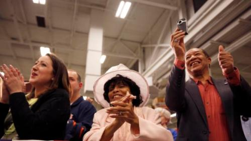 Supporters applaud as the listen to Democratic presidential candidate Hillary Clinton speak during a campaign stop at a union hall on Friday, Dec. 11, 2015, in St. Louis. (AP Photo/Jeff Roberson)