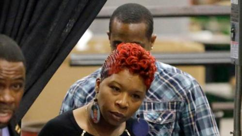 Lesley McSpadden, the mother of Michael Brown, enters a event for Democratic presidential candidate Hillary Clinton at a union hall on Friday, Dec. 11, 2015, in St. Louis. Brown was shot and killed by a Ferguson police officer in Aug. 2014 setting off the Black Lives Matter movement. (AP Photo/Jeff Roberson)