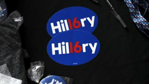 Merchandise waits to be purchased by supporters at a campaign rally for U.S. Democratic presidential candidate Hillary Clinton in Tulsa, Oklahoma December 11, 2015. REUTERS/Nick Oxford