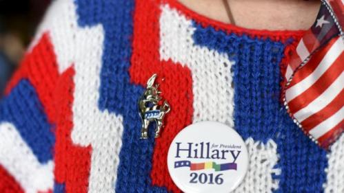 Volunteer Diane Helt wears her hand knitted patriotic sweater and custom donkey pin at a campaign rally for U.S. Democratic presidential candidate Hillary Clinton in Tulsa, Oklahoma December 11, 2015. REUTERS/Nick Oxford