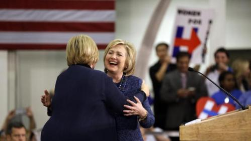Democratic presidential candidate Hillary Clinton hugs Sen. Claire McCaskill, D-Mo., left, before speaking to supporters during a campaign stop at a union hall on Friday, Dec. 11, 2015, in St. Louis. (AP Photo/Jeff Roberson)