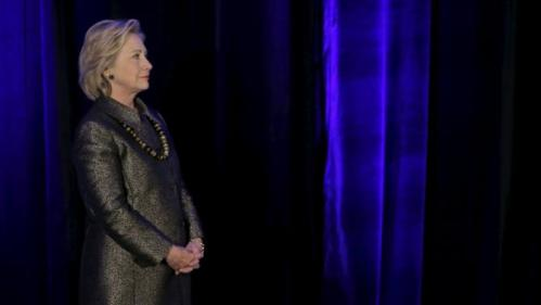 Democratic U.S. presidential candidate Hillary Clinton stands on stage as she is introduced before addressing the 2015 National Immigrant Integration Conference in the Brooklyn borough of New York City, December 14, 2015. REUTERS/Mike Segar