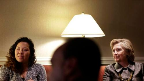 Democratic presidential candidate Hillary Clinton, right, meets with members of the Suarez family, including Marcy Yonaly Suarez Canales, left, before speaking at the 2015 National Immigration Integration Conference in New York, Monday, Dec. 14, 2015. (AP Photo/Seth Wenig)