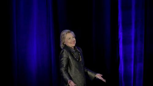 Democratic U.S. presidential candidate Hillary Clinton reacts before addressing the 2015 National Immigrant Integration Conference in the Brooklyn borough of New York City, December 14, 2015. REUTERS/Mike Segar