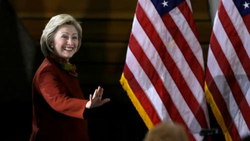 Democratic presidential candidate Hillary Clinton waves to supporters before speaking about her counterterrorism strategy during a speech at the University of Minnesota Tuesday, Dec. 15, 2015, in Minneapolis. (AP Photo/Charlie Neibergall)