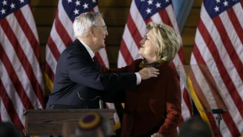 Former Vice President Walter Mondale hugs Democratic presidential candidate Hillary Clinton after introducing her to speak about her counterterrorism strategy during a speech at the University of Minnesota Tuesday, Dec. 15, 2015, in Minneapolis. (AP Photo/Charlie Neibergall)