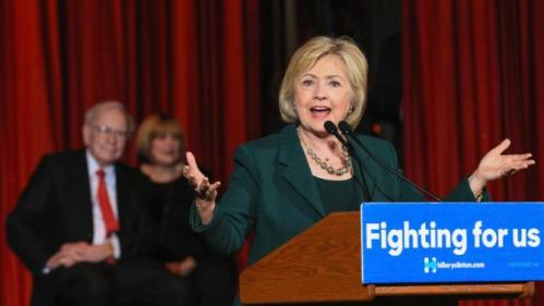 Democratic presidential candidate Hillary Clinton, accompanied by billionaire investor Warren Buffett and his daughter Suzie, speaks at a Grassroots Organizing Event in Omaha, Neb., Wednesday, Dec. 16, 2015. (AP Photo/Nati Harnik)