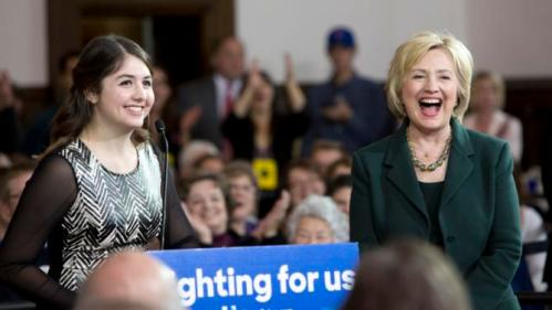 Democratic presidential candidate Hillary Clinton laughs as she is introduced by University of Iowa student Cassidy Schubatt, 19, at a campaign event Wednesday, Dec. 16, 2015, at the Old Brick Church in Iowa City, Iowa. (AP Photo/Scott Morgan)