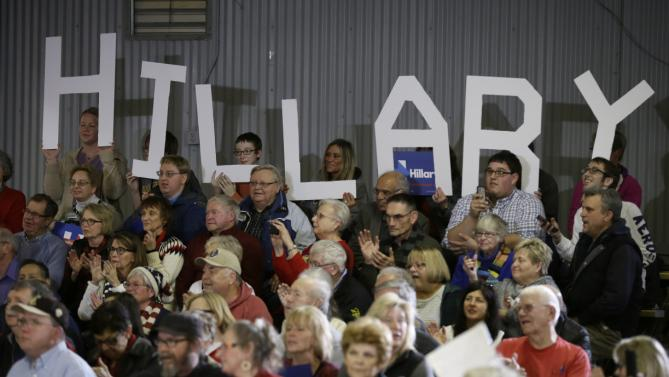 Audience members look on as Democratic presidential candidate Hillary Clinton speaks during a town hall meeting Wednesday, Dec. 16, 2015, in Mason City, Iowa. (AP Photo/Charlie Neibergall)