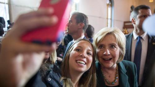Democratic presidential candidate Hillary Clinton takes a photo with a supporter after speaking at a campaign event Wednesday, Dec. 16, 2015, at the Old Brick Church in Iowa City, Iowa. (AP Photo/Scott Morgan)