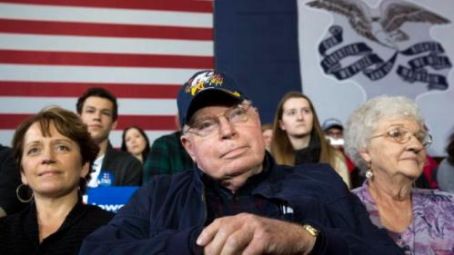 Art Tellin of Solon, Iowa listens as Democratic presidential candidate Hillary Clinton speaks at a campaign event Wednesday, Dec. 16, 2015, at the Old Brick Church in Iowa City, Iowa. (AP Photo/Scott Morgan)