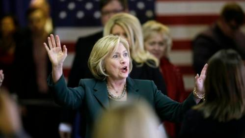 Democratic presidential candidate Hillary Clinton reacts to supporters during a town hall meeting Wednesday, Dec. 16, 2015, in Mason City, Iowa. (AP Photo/Charlie Neibergall)