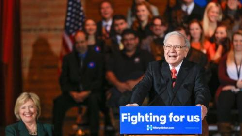 Democratic presidential candidate Hillary Clinton laughs as billionaire investor Warren Buffett speaks at a Clinton Grassroots Organizing Event in Omaha, Neb., Wednesday, Dec. 16, 2015. (AP Photo/Nati Harnik)