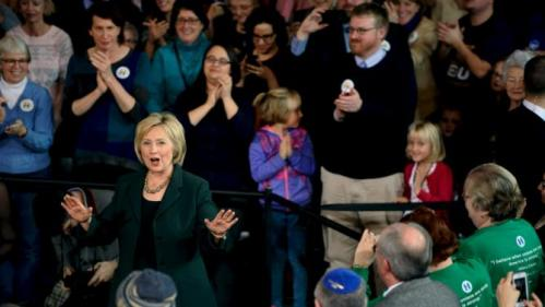 U.S. Democratic presidential candidate Hillary Clinton calms the crowd during a town hall event at Old Brick Church and Community Center in Iowa City, Iowa, December 16, 2015. REUTERS/Mark Kauzlarich