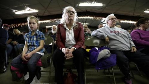 Audience members listen as Democratic presidential candidate Hillary Clinton speaks during a town hall meeting Wednesday, Dec. 16, 2015, in Mason City, Iowa. (AP Photo/Charlie Neibergall)