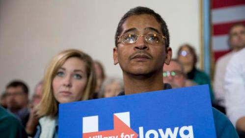 Reda Soliman, an immigrant from Egypt living in Iowa City, listen as Democratic presidential candidate Hillary Clinton speaks at a campaign event Wednesday, Dec. 16, 2015, at the Old Brick Church in Iowa City, Iowa. (AP Photo/Scott Morgan)