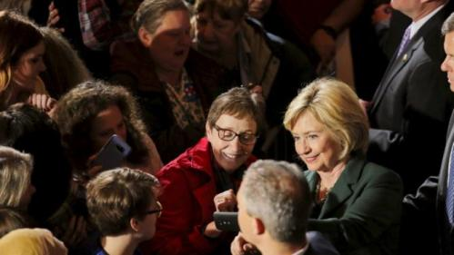 U.S. Democratic presidential candidate Hillary Clinton (R) takes a selfie with a supporter during a campaign rally in Omaha, Nebraska, December 16, 2015. REUTERS/Lane Hickenbottom