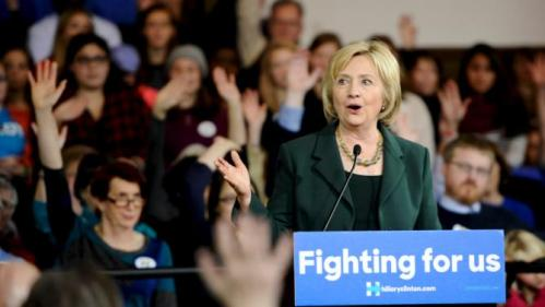 U.S. Democratic presidential candidate Hillary Clinton asks attendees for a show of hands from those who have caucused during a town hall event at Old Brick Church and Community Center in Iowa City, Iowa, December 16, 2015. REUTERS/Mark Kauzlarich