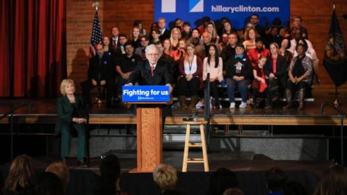 Democratic presidential candidate Hillary Clinton, center left, listens as billionaire investor Warren Buffett speaks at a Clinton Grassroots Organizing Event in Omaha, Neb., Wednesday, Dec. 16, 2015. (AP Photo/Nati Harnik)