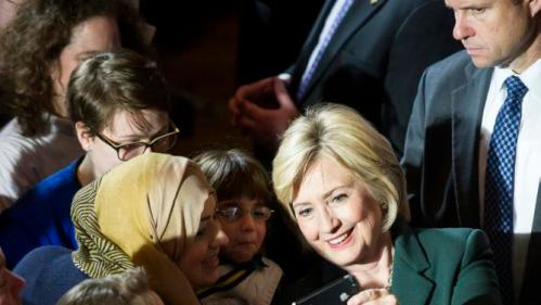 Democratic presidential candidate Hillary Clinton takes a selfie with a supporter after delivering a campaign speech, Wednesday, Dec. 16, 2015, at Sokol Auditorium in Omaha, Neb. (Kristin Streff/The Journal-Star via AP) LOCAL TELEVISION OUT; KOLN-TV OUT; KGIN-TV OUT; KLKN-TV OUT; MANDATORY CREDIT