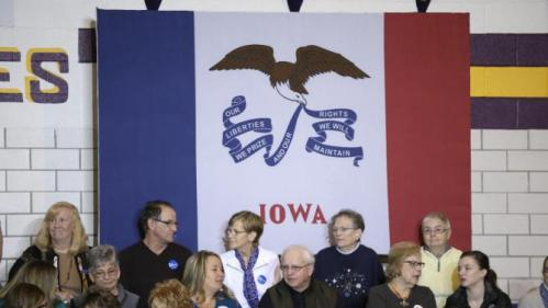 Audience members wait for Democratic presidential candidate Hillary Clinton to arrive at a town hall meeting at Keota High School, Tuesday, Dec. 22, 2015, in Keota, Iowa. (AP Photo/Charlie Neibergall)