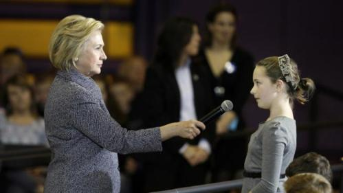 Democratic presidential candidate Hillary Clinton listens to a question from fifth-grader Hannah Tandy during a town hall meeting at Keota High School, Tuesday, Dec. 22, 2015, in Keota, Iowa. (AP Photo/Charlie Neibergall)