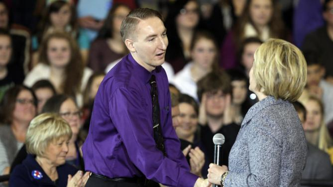 Teacher Schuyler Snakenberg greets Democratic presidential candidate Hillary Clinton during a town hall meeting at Keota High School, Tuesday, Dec. 22, 2015, in Keota, Iowa. (AP Photo/Charlie Neibergall)