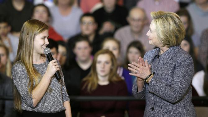 Democratic presidential candidate Hillary Clinton reacts as she is introduced by student Abby Schulte to speak at a town hall meeting at Keota High School, Tuesday, Dec. 22, 2015, in Keota, Iowa. (AP Photo/Charlie Neibergall)