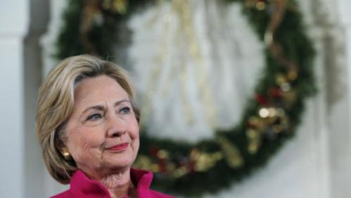 U.S. Democratic presidential candidate Hillary Clinton listens as she is introduced at a campaign town hall meeting at South Church in Portsmouth, New Hampshire, December 29, 2015. REUTERS/Brian Snyder