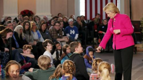 U.S. Democratic presidential candidate Hillary Clinton takes a question from young audience member at a campaign town hall meeting at South Church in Portsmouth, New Hampshire, December 29, 2015. REUTERS/Brian Snyder