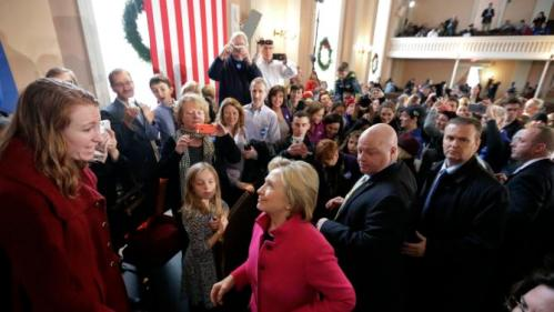 Democratic presidential candidate Hillary Clinton speaks with Marissa Chase of Manchester, N.H., left, at the conclusion of a town hall style campaign event, Tuesday, Dec. 29, 2015, at South Church in Portsmouth, N.H. (AP Photo/Steven Senne)